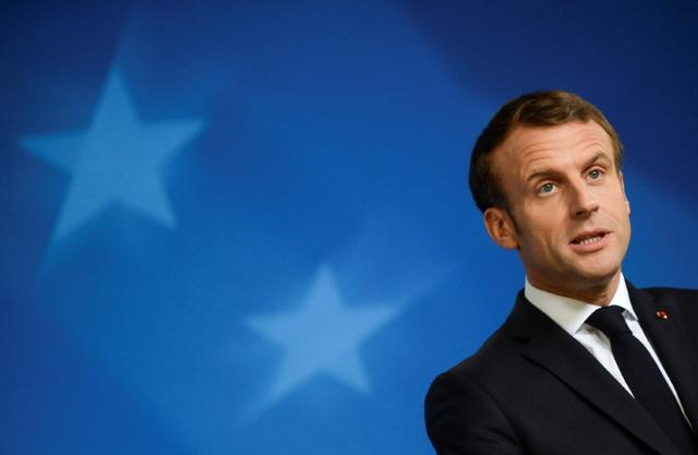 FILE PHOTO: French President Emmanuel Macron speaks during a news conference at the end of the European Union leaders summit dominated by Brexit, in Brussels, Belgium October 18, 2019. REUTERS/Johanna Geron/File Photo