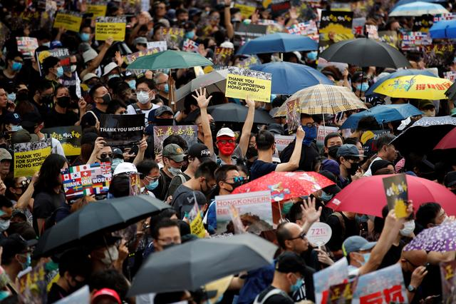 Anti-government protesters gather at the start of a protest march in Hong Kong's tourism district of Tsim Sha Tsui, China October 20, 2019. REUTERS/Umit Bektas