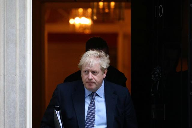 Britain's Prime Minister Boris Johnson leaves Downing Street to head for the House of Commons as parliament discusses Brexit, sitting on a Saturday for the first time since the 1982 Falklands War, in London, Britain, October 19, 2019. REUTERS/Tom Nicholson