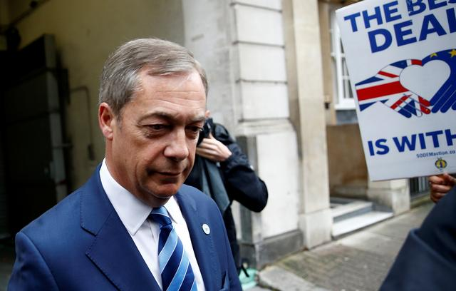 FILE PHOTO: Britain's Brexit Party leader Nigel Farage leaves a TV studio in Westminster, London, Britain September 25, 2019. REUTERS/Henry Nicholls