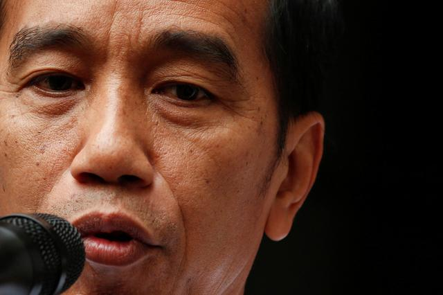 FILE PHOTO: Indonesia's President Joko Widodo talks during a news conference at Gatot Subroto military hospital in Jakarta, Indonesia, October 10, 2019. REUTERS/Willy Kurniawan
