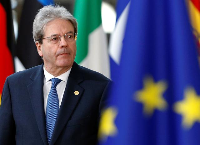 FILE PHOTO: EU economics commissioner Paolo Gentiloni, pictured when Italian prime minister arriving at a European Union leaders summit in Brussels, Belgium, March 22, 2018. REUTERS/Francois Lenoir