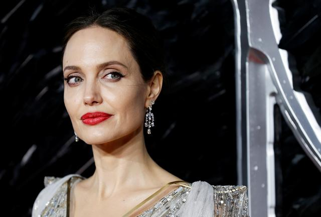 "FILE PHOTO: Actor Angelina Jolie poses as she attends the UK premiere of ""Maleficent: Mistress of Evil"" in London, Britain October 9, 2019. REUTERS/Peter Nicholls"