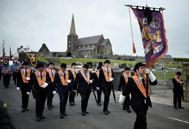 FILE PHOTO: Participants in an Orange Order march past Drumcree Parish Church in Portadown, Northern Ireland July 9, 2017. REUTERS/Clodagh Kilcoyne/File Photo