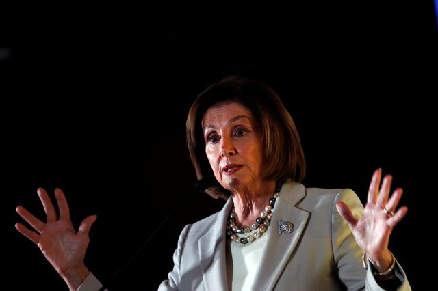 FILE PHOTO: U.S. House Speaker Nancy Pelosi (D-CA) addresses the audience during the Democratic National Committee's (DNC) 2019 Women's Leadership Forum in Washington, U.S. October 17, 2019. REUTERS/Carlos Jasso