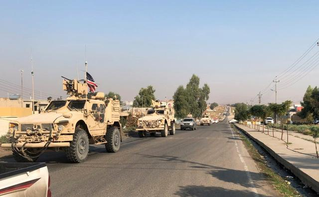 A convoy of U.S. vehicles are seen after withdrawing from northern Syria, at the Iraqi-Syrian border crossing in the Sahela border in the northern province of Dohuk, Iraq, October 21, 2019. REUTERS/Kawa Omar