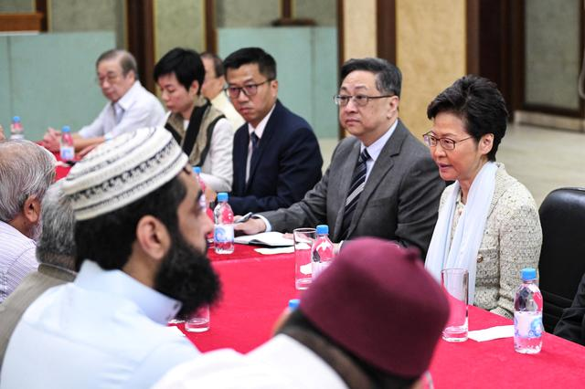 Hong Kong's Chief Executive Carrie Lam (R) and Commissioner of Police, Lo Wai-chung meet with representatives of the Incorporated Trustees of the Islamic Community Fund of Hong Kong and other leaders of the local Muslim community at the Kowloon Masjid and Islamic Centre in Tsim Sha Tsui, in Hong Kong, China October 21, 2019. Information Services Department/Handout via REUTERS