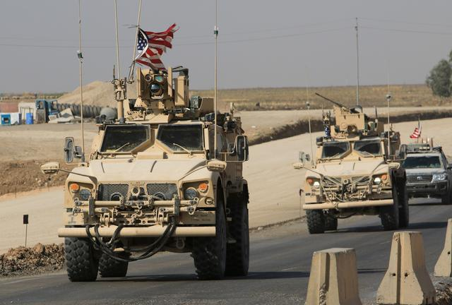 A convoy of U.S. vehicles is seen after withdrawing from northern Syria, at the Iraqi-Syrian border crossing in the outskirts of Dohuk,, Iraq, October 21, 2019. REUTERS/Ari Jalal