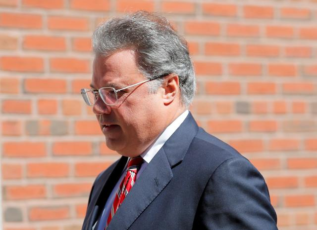 FILE PHOTO: Manuel Henriquez, founder and chairman and CEO of Hercules Technology Growth Capital, facing charges in a nationwide college admissions cheating scheme, enters federal court in Boston, Massachusetts, U.S., April 3, 2019.  REUTERS/Brian Snyder/File Photo