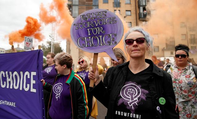 FILE PHOTO: Pro-choice demonstrators take part in a march in Belfast, Northern Ireland September 7, 2019. REUTERS/John Sibley