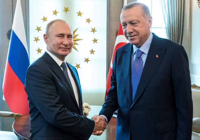 FILE PHOTO: Russian President Vladimir Putin, left, and Turkish President Recep Tayyip Erdogan shake hands during their meeting in Ankara, Turkey September 16, 2019. Pavel Golovkin/Pool via REUTERS/File Photo