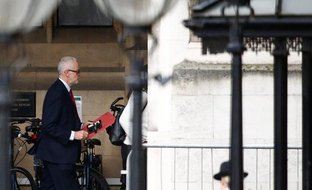 Britain's opposition Labour Party Leader Jeremy Corbyn walks outside the Houses of Parliamet in London, Britain, October 21, 2019. REUTERS/Henry Nicholls