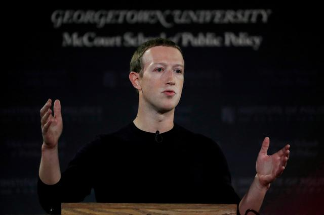 "FILE PHOTO: Facebook Chairman and CEO Mark Zuckerberg addresses the audience on ""the challenges of protecting free speech while combating hate speech online, fighting misinformation, and political data privacy and security,"" at a forum hosted by Georgetown University's Institute of Politics and Public Service (GU Politics) and the McCourt School of Public Policy in Washington, U.S., October 17, 2019. REUTERS/Carlos Jasso"