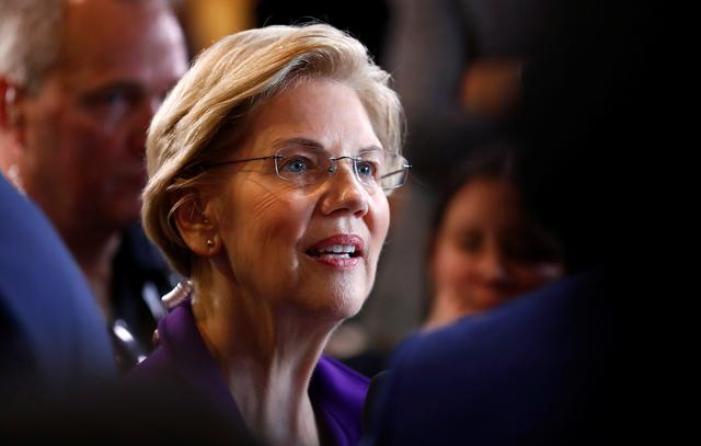 FILE PHOTO: Senator Elizabeth Warren does an interview in the Spin Room after the fourth Democratic U.S. 2020 presidential election debate at Otterbein University  in Westerville, Ohio October 15, 2019. REUTERS/Aaron Josefczyk/File Photo