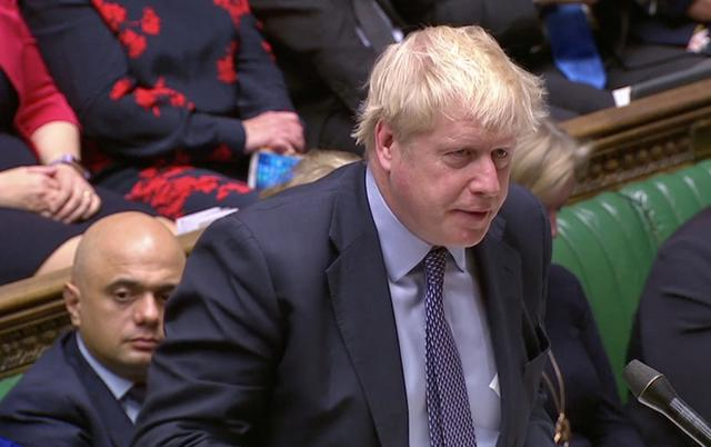 FILE PHOTO: Britain's Prime Minister Boris Johnson speaks at the House of Commons as parliament discusses Brexit, sitting on a Saturday for the first time since the 1982 Falklands War, in London, Britain, October 19, 2019, in this screen grab taken from video. Parliament TV via REUTERS
