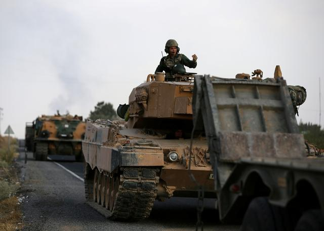 FILE PHOTO: Turkish army vehicles are moving on a road near the Turkish border town of Ceylanpinar, Sanliurfa province, Turkey, October 18, 2019. REUTERS/Stoyan Nenov/File Photo