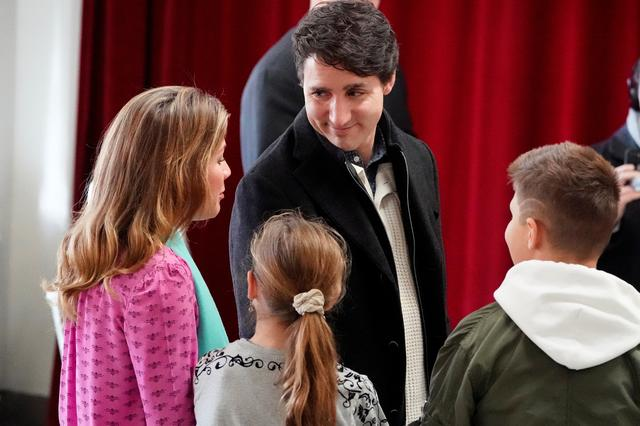 Justin Trudeau, with his family, arrives to cast his ballot for today's election in the Papineau area of Montreal, Quebec, Canada, October 21, 2019. REUTERS/Carlo Allegri