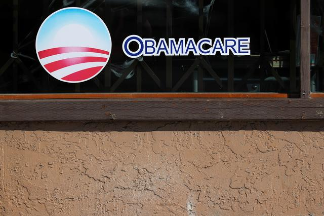 A sign on an insurance store advertises Obamacare in San Ysidro, San Diego, California, U.S., October 26, 2017. REUTERS/Mike Blake/File Photo