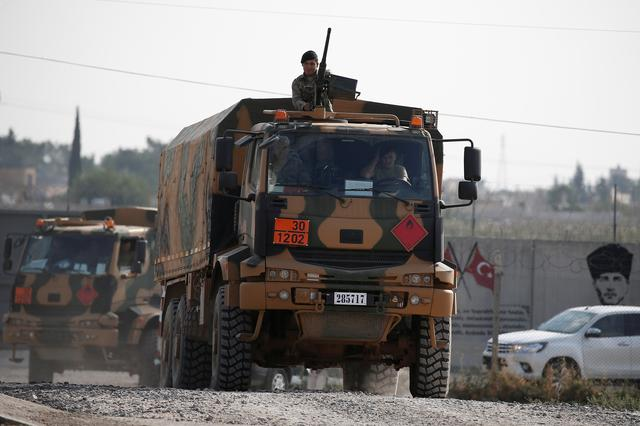 Turkish soldiers in trucks return from the Syrian town of Tal Abyad, as they are pictured on the Turkish-Syrian border in Akcakale, Turkey, October 21, 2019. REUTERS/Huseyin Aldemir