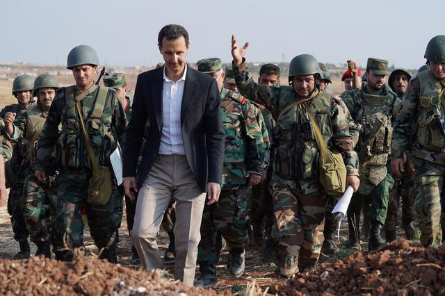Syrian President Bashar al Assad visits Syrian army troops in war-torn northwestern Idlib province, Syria, in this handout released by SANA on October 22, 2019. SANA/Handout via REUTERS