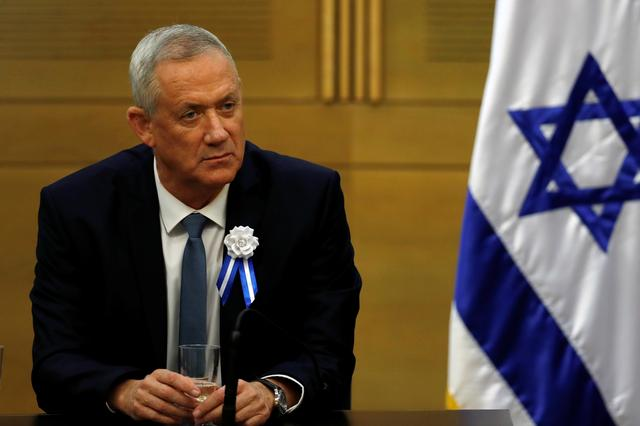 FILE PHOTO: Benny Gantz, leader of Blue and White party looks on during his party faction meeting at the Knesset, Israel's parliament, in Jerusalem October 3, 2019. REUTERS/Ronen Zvulun/File Photo