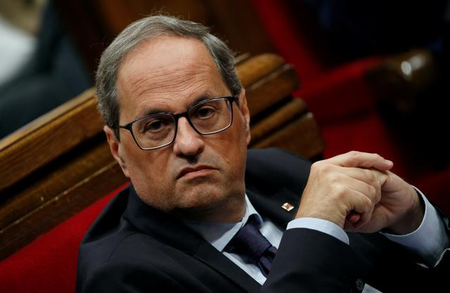 FILE PHOTO: Catalan leader Quim Torra sits in the Parliament of Catalonia after Spain's Supreme Court jailed nine separatist leaders, triggering violent protests in the region, in Barcelona, Spain, October 17, 2019. REUTERS/Albert Gea