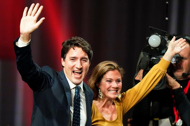 Liberal leader and Canadian Prime Minister Justin Trudeau and his wife Sophie Gregoire Trudeau wave on stage after the federal election at the Palais des Congres in Montreal, Quebec, Canada October 22, 2019. REUTERS/Carlo Allegri