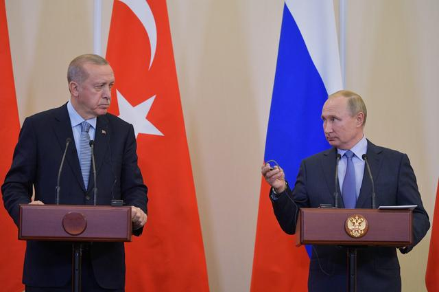 Russian President Vladimir Putin and Turkish President Tayyip Erdogan attend a news conference following their talks in Sochi, Russia October 22, 2019. Sputnik/Alexei Druzhinin/Kremlin via REUTERS