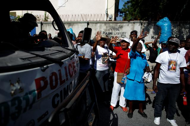 Faithful shout slogans next to a Haitian National Police (PNH) truck outside of Christ Roi church before a march organised by religious leaders in Port-au-Prince, Haiti October 22, 2019. REUTERS/Andres Martinez Casares
