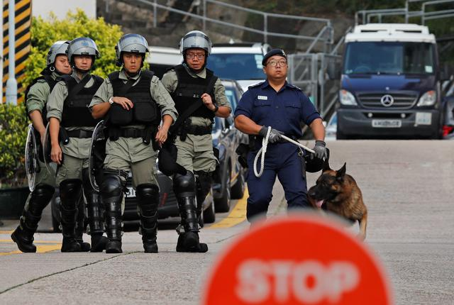 Members of the Correctional Emergency Response Team stand guard as they wait for Chan Tong-kai, a Hong Kong citizen who was accused of murdering his girlfriend in Taiwan last year, to leave from Pik Uk Prison, in Hong Kong, China October 23, 2019. REUTERS/Tyrone Siu