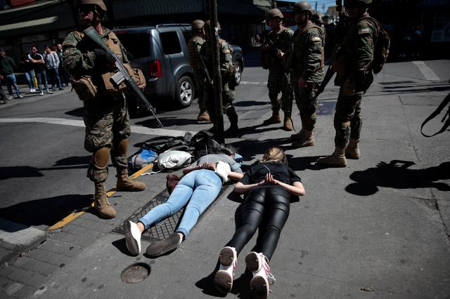 Soldiers detain suspected looters as protests against high living costs continue, in Concepcion, Chile October 22, 2019. REUTERS/Juan Gonzalez