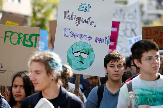 Activists hold placards during a pro-climate demonstration march in Lausanne, Switzerland September 27, 2019. REUTERS/Denis Balibouse