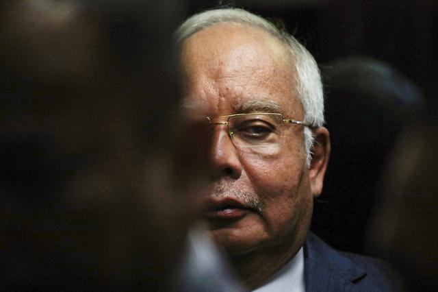 FILE PHOTO: Former Malaysian Prime Minister Najib Razak arrives at Kuala Lumpur High Court in Kuala Lumpur, Malaysia, August 19, 2019. REUTERS/Lim Huey Teng/File Photo