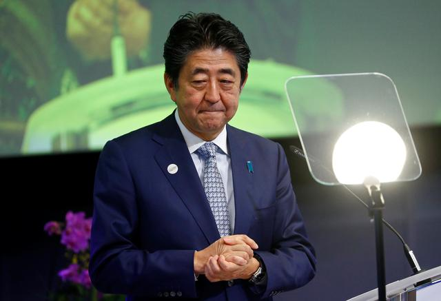FILE PHOTO: Japan's Prime Minister Shinzo Abe speaks attends the conference Communication Connecting Europe and Asia, in Brussels, Belgium September 27, 2019. REUTERS/Francois Lenoir/File Photo