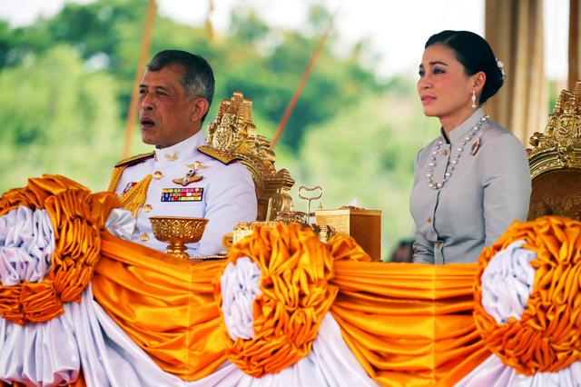 FILE PHOTO: Thailand's King Maha Vajiralongkorn and Queen Suthida attend the annual Royal Ploughing Ceremony in central Bangkok, Thailand, May 9, 2019. REUTERS/Athit Perawongmetha/File Photo