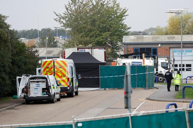 Police is seen at the scene where bodies were discovered in a lorry container, in Grays, Essex, Britain October 23, 2019.  REUTERS/Peter Nicholls