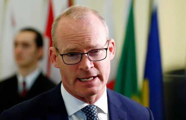 FILE PHOTO: Irish Foreign Minister Simon Coveney speaks as he leaves the General Affairs council addressing the state of play of Brexit, in Luxembourg October 15, 2019.  REUTERS/Francois Lenoir/File Photo