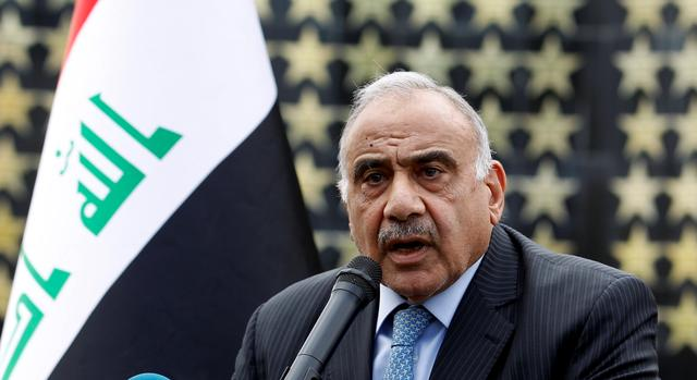Iraqi Prime Minister Adel Abdul Mahdi speaks during a symbolic funeral ceremony of Major General Ali al-Lami, who commands the Iraqi Federal Police's Fourth Division, who was killed in Salahuddin, in Baghdad, Iraq October 23, 2019. REUTERS/Khalid al-Mousily