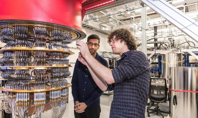 A handout picture from October 2019 shows Sundar Pichai and Daniel Sank (R) with one of Google's Quantum Computers in the Santa Barbara lab, California, U.S. Picture taken in October 2019.      Google/Handout via REUTERS