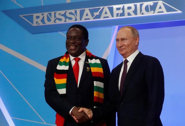 Russian President Vladimir Putin shakes hands with Zimbabwean President Emmerson Mnangagwa during an official welcome ceremony for heads of states and governments of member-states of Russia-Africa Summit in the Black sea resort of Sochi, Russia, October 23, 2019. Sergei Chirikov/Pool via REUTERS