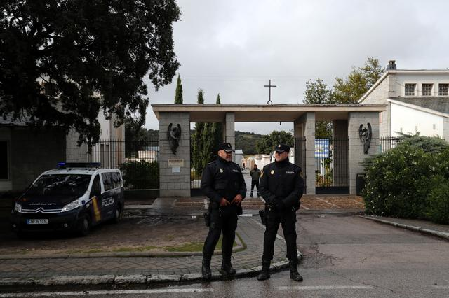 Spanish National Police officers stand near the mausoleum where Spanish late dictator Francisco Franco is expected to be buried on Thursday at Mingorrubio-El Pardo cemetery in Madrid, Spain, October 23, 2019. REUTERS/Susana Vera