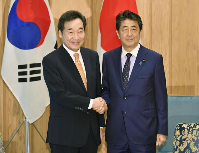South Korea's Prime Minister Lee Nak-yon meets with Japan's Prime Minister Shinzo Abe at Abe's official residence in Tokyo, Japan October 24, 2019, in this photo released by Kyodo. Mandatory credit Kyodo/via REUTERS