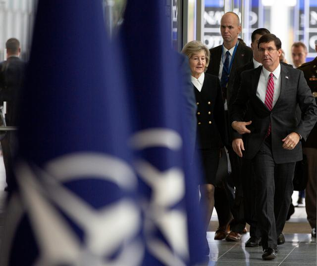 U.S. Secretary for Defense Mark Esper and U.S. Ambassador to NATO Kay Bailey Hutchison arrive for a meeting of NATO defense ministers at NATO headquarters in Brussels, Belgium October 24, 2019. Virginia Mayo/Pool via REUTERS
