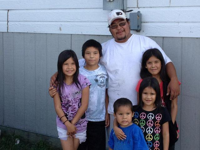 Tyson McKay, of the northern Manitoba indigenous community of Cross Lake, poses with his nieces and nephews in the fall of 2014.  Kelvin McKay via REUTERS.