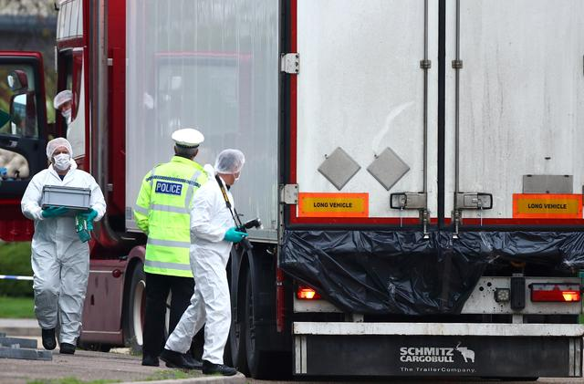 FILE PHOTO: Police are seen at the scene where bodies were discovered in a lorry container, in Grays, Essex, Britain October 23, 2019.  REUTERS/Hannah McKay/File Photo