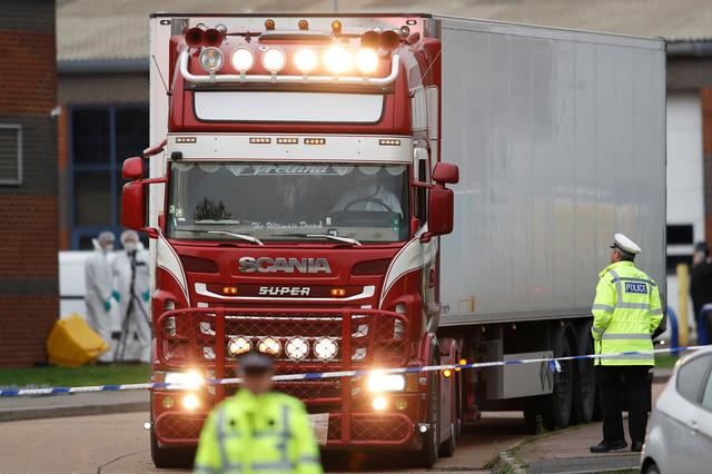 FILE PHOTO: Police move the lorry container where bodies were discovered, in Grays, Essex, Britain October 23, 2019.  REUTERS/Peter Nicholls/File Photo