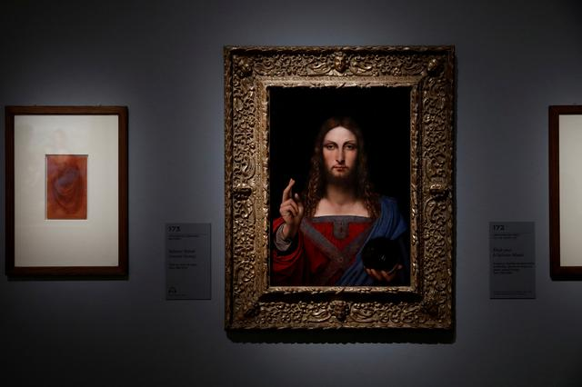 """FILE PHOTO: The painting """"Salvator Mundi"""" by School of Leonardo da Vinci is pictured during a press visit of the """"Leonardo da Vinci"""" exhibition to commemorate the 500-year anniversary of his death, at the Louvre Museum in Paris, France, October 20, 2019. REUTERS/Benoit Tessier/File Photo"""