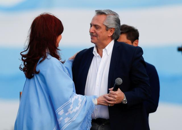 FILE PHOTO: Argentina's presidential candidate Alberto Fernandez and his running mate former President Cristina Fernandez embrace each other during a closing campaign rally in Mar del Plata, Argentina October 24, 2019. REUTERS/Agustin Marcarian/File Photo