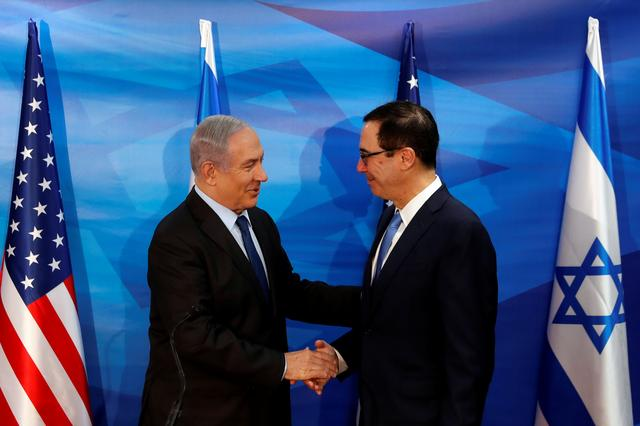 Israeli Prime Minister Benjamin Netanyahu and U.S. Treasury Secretary Steven Mnuchin shake hands as they deliver joint statements during their meeting in Jerusalem October 28, 2019. REUTERS/Ronen Zvulun
