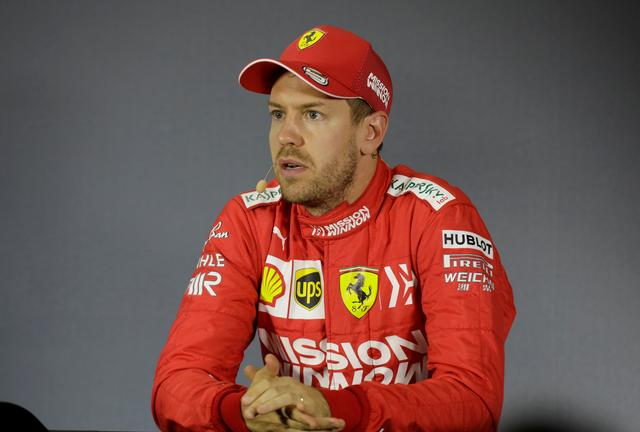 Vettel Takes Issue With Selfie Guy And Sponsored Trophy